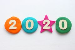 2020 background .The concept of the new 2020. New year with colorful numbers 2020 on white background. Christmas card, congratulat. Ions. Copy space royalty free stock photography