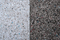 Background of a concrete wall and multi-colored gravel with a texture of two vertical parts - white and gray. Horizontal frame Stock Photography