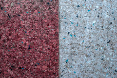 Background of a concrete wall and multi-colored gravel with a texture of two vertical parts - white and red. Horizontal frame Royalty Free Stock Photo