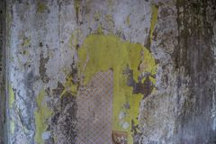 Background concrete wall, traces of weathering, worn wall damaged paint old paint. Remains of old paint on the painted concrete su. The texture is old paint and royalty free stock image