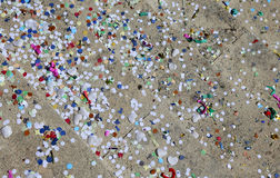 Background of confetti and streamers after the Carnival party Stock Images