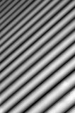 Background consisting of light and dark stripes of diagonally with a gradual blurring Stock Images
