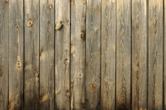 Background consisting of old wooden boards. Partially tinted photo Stock Images