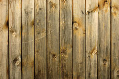 Background consisting of old wooden boards. Partially tinted photo Stock Photography