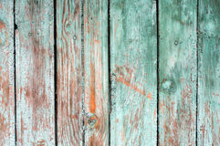 Background consisting of old wooden boards with traces of peeling paint. Royalty Free Stock Photography