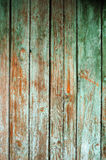 Background consisting of old wooden boards with traces of peeling paint. Stock Photo