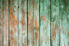 Background consisting of old wooden boards with traces of peeling paint. Stock Images