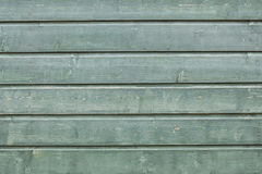 Background consisting of weathered green grey boards Stock Image
