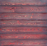 Background consisting of wooden horizontal planks coloured with red-black paint Royalty Free Stock Photo