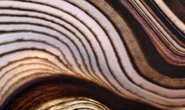 Contrast agate dark anl light brown lines. Background with contrast agate structure royalty free stock image