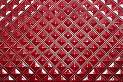Background of convex shiny design. Convex shiny design on red plastic Stock Image