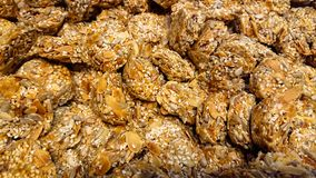 Background of cookies from almond flakes and sesame seeds royalty free stock photography