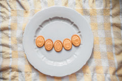 Background with cookies in the shape of Easter eggs with cookies on a gray plate Stock Photos