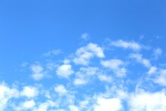 Background. Blue sunny sky with beautiful clouds. Royalty Free Stock Photos