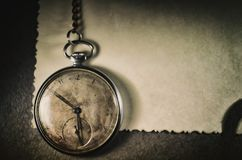 background with copy space for text. Old pocket watch on books with chain in dirty environment. stock images