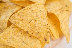 Background of corn tortillas or Nachos fried on open fire. Copy space. Close up stock image