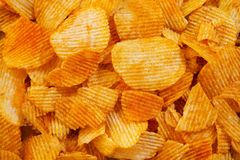 Background corrugated golden chips with texture. Food texture. potato chips.Top view. Mock up. Copy space.Template. Blank. Background corrugated golden chips royalty free stock photo