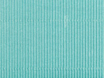 Background from corrugated shiny green color pape Stock Photo