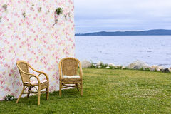 Background and couple of chairs on lakeshore Royalty Free Stock Images