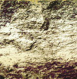 Background with cracked brown, gray and beige rock structure Royalty Free Stock Image