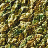 Background of cracked brown and green rock stucture. Abstract background of crystals and sharp stones Stock Photos