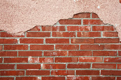 Brick wall with cracked concrete Royalty Free Stock Photos