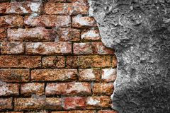 Brick wall with cracked concrete Stock Images