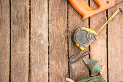 Background Craftsman tool have saw and   plumb bob and tape measure.On wooden background.right corner Stock Image