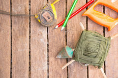 Background Craftsman tool have saw  and   plumb bob and tape measure .On wooden background.Screen for carpenter. Royalty Free Stock Photos