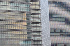 Background of cramped tall office building glass exterior. In horizontal frame stock image