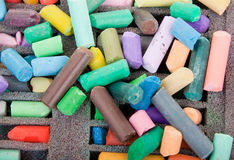 Background of crayons. Crayons for drawing scattered randomly as the background Royalty Free Stock Photos