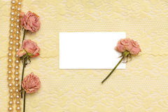 Background with cream silky, pearls and roses Royalty Free Stock Image
