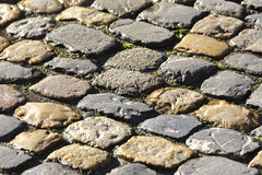 Background created by cobbled road. Cobbled stone road shown up close creates stony background Royalty Free Stock Photography