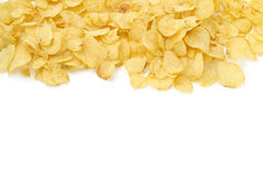 Background of crisps. Pile of crisps on upper border with blank space stock image
