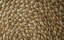 Background crisscross with straw basics, bag with straw, handmade, craft. Texture of painted straw bag close up. nature background. Background crisscross with royalty free stock photo