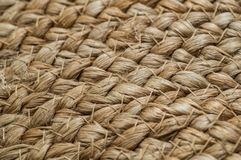 Background crisscross with straw basics, bag with straw, handmade, craft. Texture of painted straw bag close up. nature background stock images