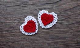 Background with crochet lace flowers and hearts Royalty Free Stock Photo