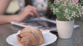 Background of a croissant flowers woman uses a phone on a desk stock footage