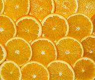 The background is crumbled with fresh whole oranges. Sliced slices Stock Photo