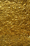 Background of crumpled gold paper Stock Photos