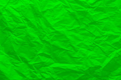Background of crumpled green paper. Wrinkled paper close-up royalty free stock photography