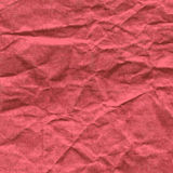 Background of crumpled paper in red color Stock Images