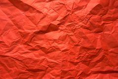 Background. Crumpled red sheet of paper. Texture. Red background. Crumpled paper Stock Photo