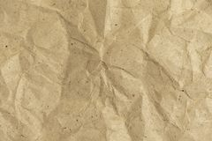 Background of crumpled wrapping paper. Rumpled paper texture.  royalty free stock photo