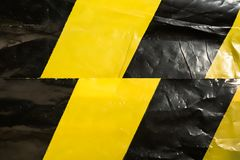 Background of a crumpled yellow protective tape stock image