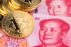 Background with crypto bitcoin and China yuan. Bitcoin with Chinese banknotes. Bitcoin and banknotes of one hundred yuan. Background with crypto bitcoin and royalty free stock images