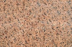 Background of crystal granite with fine black and gray grains. Royalty Free Stock Photo