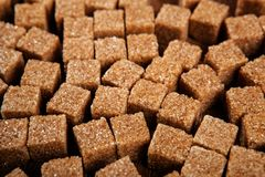 Background of cubes of brown sugar Stock Photo