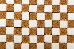 Background of cubes of brown and white sugar Royalty Free Stock Image