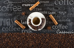 Background of cup coffee beans with cinnamon and anise royalty free stock images